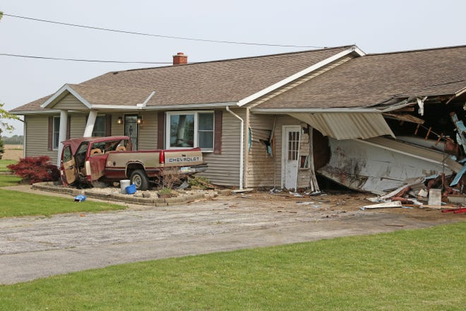 The home of Charles Walker, 162 W. County Road 201 received heavy damage when a car left the road and hit his garage and pickup truck, which was parked in front of the garage. The pickup was pushed into the front porch of the house. A passenger in the vehicle received severe injuries, and the as yet unidentified driver has not been found.