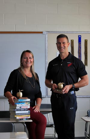 From left, Jamie Ayres, English teacher at Cape Coral High School, and retired Army Major Bryan Williams, JROTC and leadership education teacher at Mariner High School are both Golden Apple winners. They pose for a portrait on Tuesday, May 11, 2021.