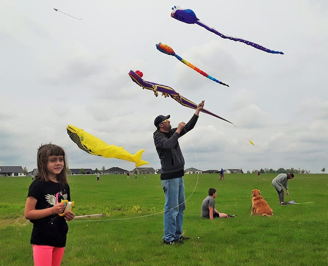 Kaitlyn Buresh of Ely and her family were among hundreds who flocked to Centennial Park in North Liberty on Sunday for the annual Mega Kites event sponsored by the city in cooperation with six area businesses. Families could bring their own kites to soar along with the huge whale, lizard and other giant kite characters dominating the skies. This festival is one of 35 free summer events planned by the city and called North Liberty's Summer Slate, all designed to comply with current public health recommendations.