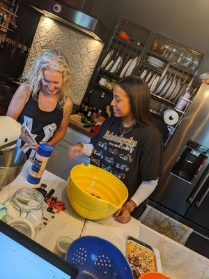 Courier Journal food columnist Dana McMahan, left, has been teaching her high school niece how to cook during her senior year in high school.