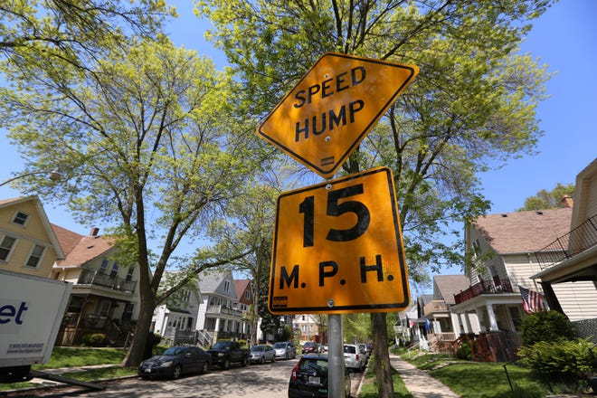A sign marks a speed hump on North Booth Street south of East Burleigh Street in Milwaukee. Efforts are underway to install a speed hump nearby where a group home is located at 3179 North Richards Street.
