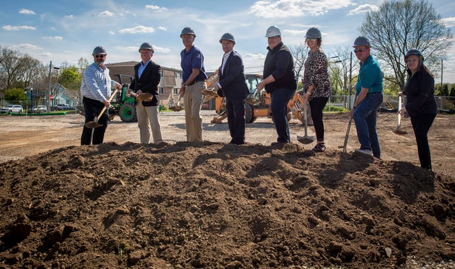 Members of the Yorktown Town Council gather along the Civic Green on May 14 for the groundbreaking of The Oliver, one of the first residential/commercial investments for Yorktown's downtown redevelopment plan.