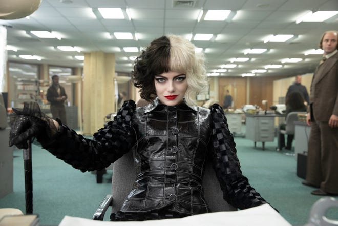"""Emma Stone plays the classic Disney villainess during her younger 1970s punk-rock fashionista days in """"Cruella,"""" which opens in theaters May 28, 2021."""