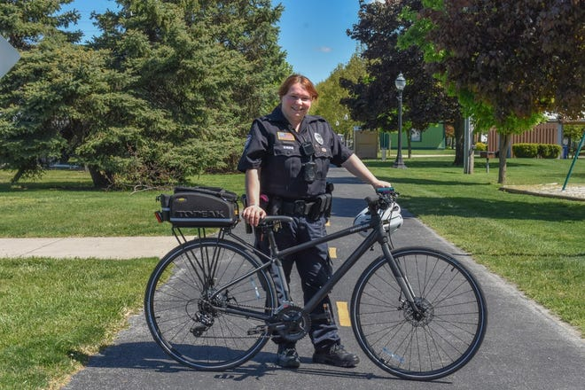 Elmore police officer Laura Condon spearheaded the department's new bike patrol as a means to better maneuver throughout the village as well as promote bike safety to area children. Here, she stands with one of the two Cannondale bicycles the department purchased with funds donated by St. Paul Trinity United Methodist Church.