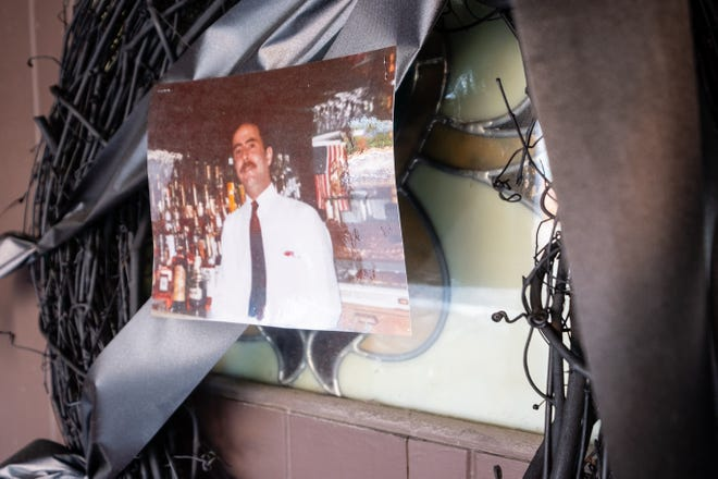 A memorial for Maroun Abou-Ghanem, owner of the Brass Rail in downtown Port Huron, hangs on the door of the bar. Abou-Ghanem died May 8.