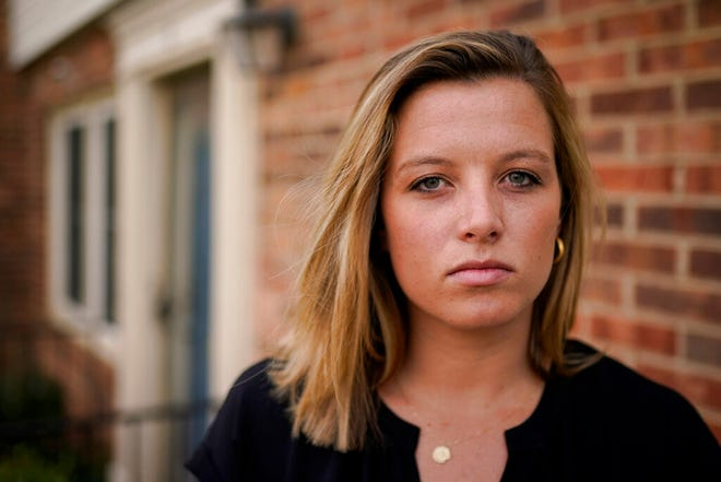 Shannon Keeler poses for a portrait in the United States on Wednesday, April 7, 2021. A series of online messages from a long-ago schoolmate has Keeler, a Gettysburg College graduate, trying again to get authorities to make an arrest in her 2013 sexual assault. (AP Photo)