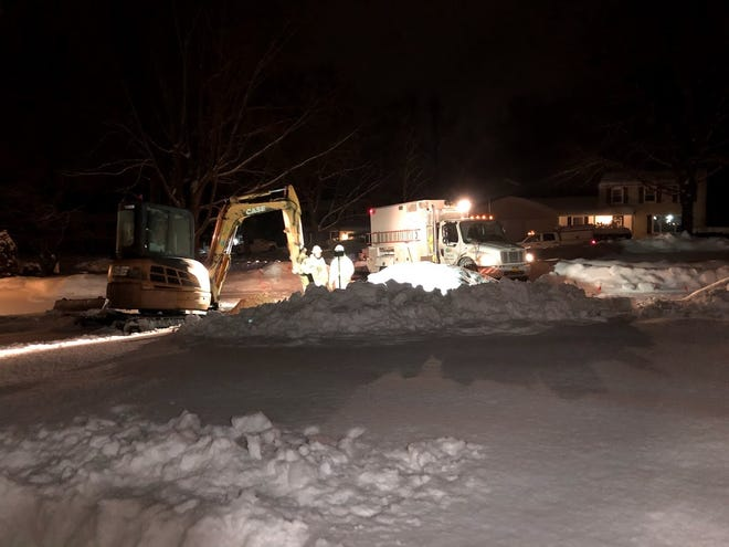 Crews dig to fix a gas leak in Penfield, New York, in the winter of 2021.