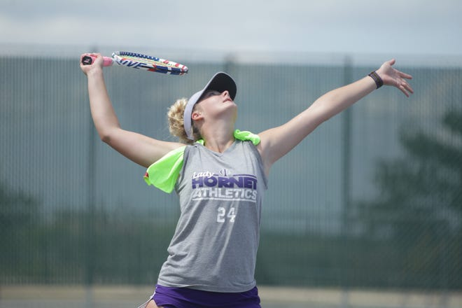 Irion County High School's Melanie Rainey prepares to hit the ball while practicing serving Monday, May 17, 2021, at the Irion County tennis courts, in preparation for the UIL State Tennis Tournament, which is Thursday and Friday in San Antonio.