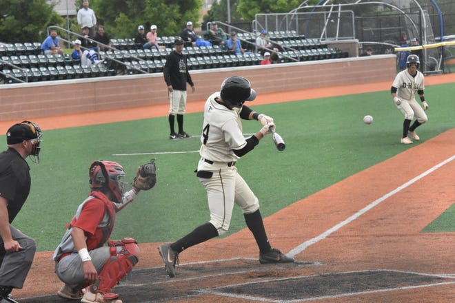 Desert Hills' Reggie Newby swings at a pitch that was a two-run RBI single.
