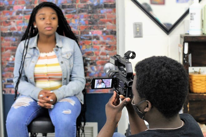 JaMalachi Willis films classmate Symone Crump performing her original monologue.