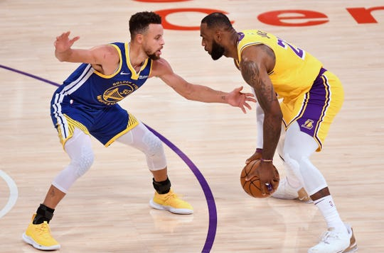 LeBron James comes out against Steph Curry during a match at the Staples Center on January 18.  The two will meet in an NBA playoff game on Wednesday.