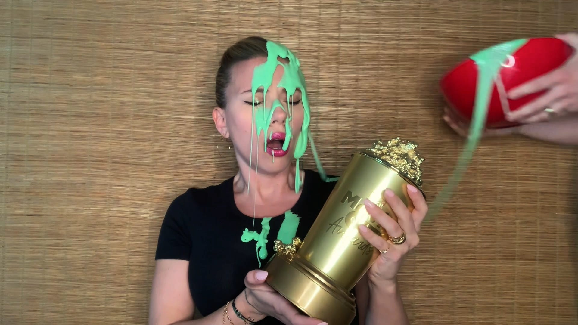 Scarlett Johansson gets slimed during MTV Awards by Colin Jost while accepting her Generation Award
