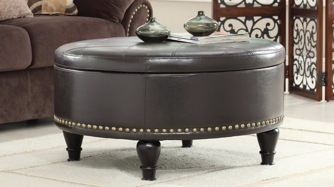 Copper Grove's round storage ottoman will look great in your living room and doubles as an extra seat.