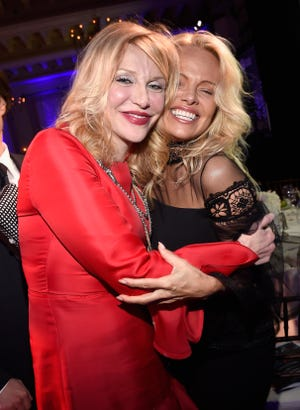 Recording artist/actress Courtney Love, left, and actress/model Pamela Anderson attend the 6th Annual Sean Penn & Friends HAITI RISING Gala Benefiting J/P Haitian Relief Organization at Montage Hotel on January 7, 2017 in Beverly Hills, California.