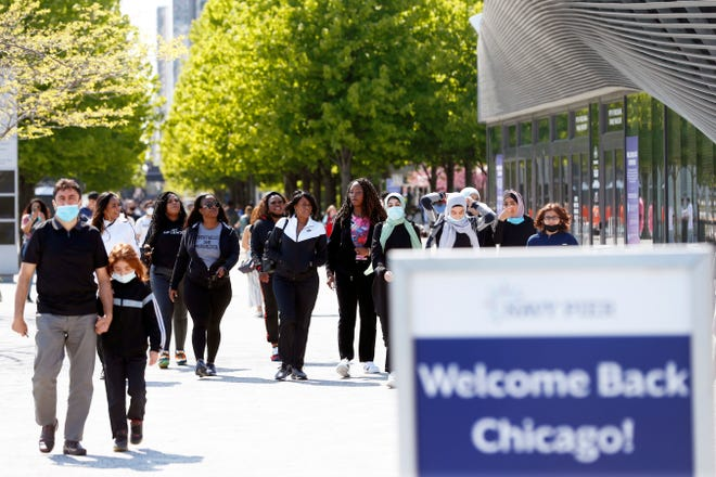 People walk along Chicago's Navy Pier, May 14, 2021.