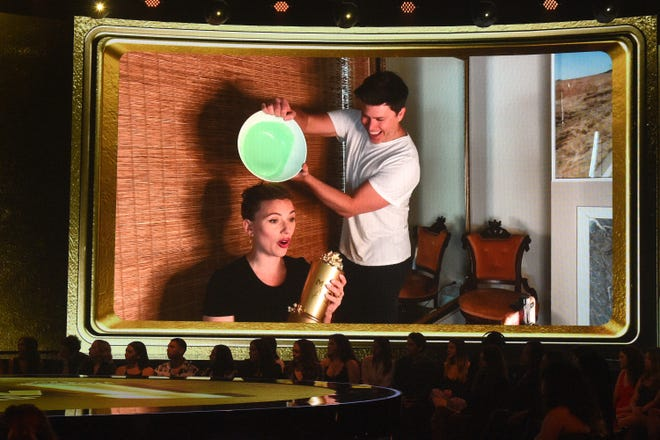 """""""What the (expletive),"""" Johansson exclaimed after getting slimed by husband Jost."""