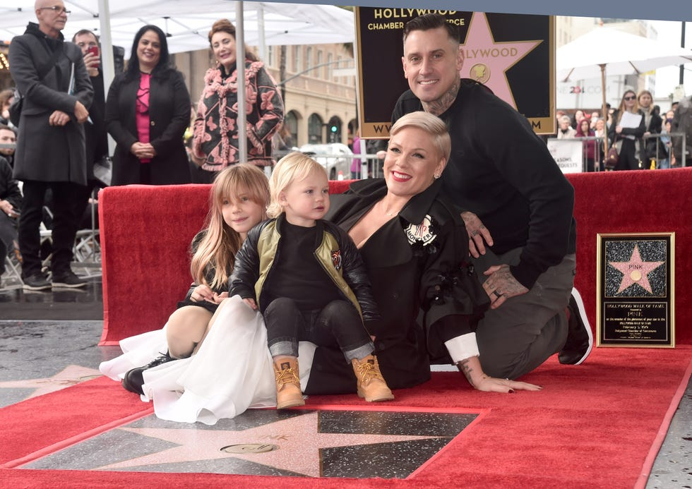 Pink poses with husband Carey Hart and children Willow and Jameson at a ceremony honoring her with a star on the Hollywood Walk of Fame in 2019.