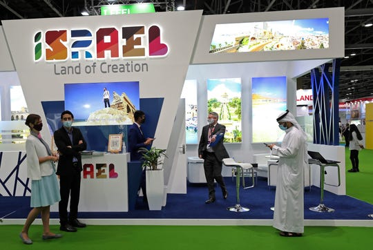 Israeli exhibitors receive visitors at their stand on the opening day of the Arabian Travel Market exhibition, in Dubai, United Arab Emirates, May 16, 2021. As violence flares within Israel, it was business as usual for a senior Israeli tourism official in Dubai as she promoted the country as a must-see destination for Muslim visitors.