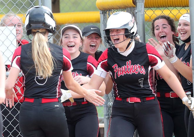 Norton's Bailey Acord, left, is greeted by teammates after hitting a home run against Tallmadge during their Division II district semifinal game at Willig Park Monday, May 17, 2021 in Canton, Ohio.
