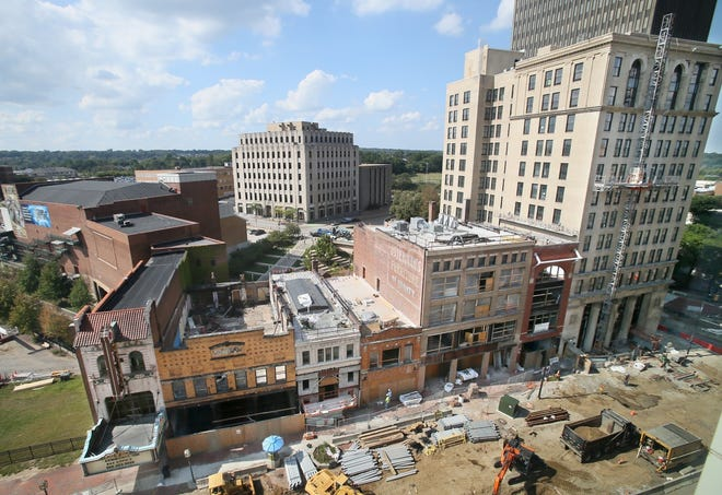 Work continues in 2019 on the Bowery Project along South Main Street in downtown Akron. The road work on South Main and renovations of the buildings are now complete ; more than 90% of apartments now have tenants. [Mike Cardew/Beacon Journal file photo]