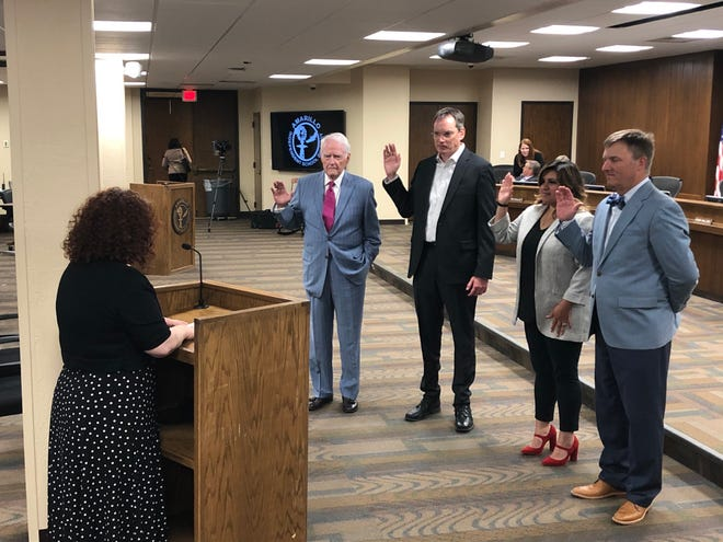 From left: Don Powell, Doyle Corder, Kayla Mendez and David Nance are sworn in after being voted into their respective seats in the May 1 election.