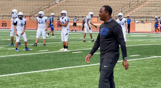 Palo Duro head coach Eric Mims coaches up his players during Monday night's Blue-White scrimmage.