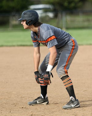 Jack Anderson leads off first base during a Division II tournament game against Chaney.