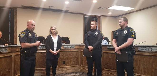 Police Chief Kevin Norris with Vice-Mayor Sheryl Ellis after presenting a Life Saving Award to Officer Dylan Davis and Corporal Skylar Bartlett after the pair saved a man threatening to jump off the roof of an Ardmore Business in April.