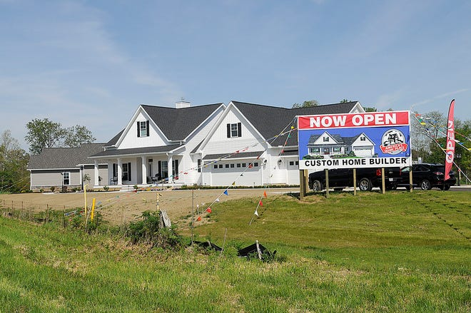 America's Home Place, located at the corner of U.S. Route 30 and Township Road 405 is seen here Tuesday, May 18, 2021. The Berglund model is in the foreground and the Brookwood model is in the background.