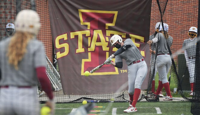 Iowa State softball players swing the bat during batting practice to prepare for the upcoming NCAA softball tournament at Iowa State University softball field Cyclone Sports Complex Monday, May 17, 2021, in Ames. Iowa.