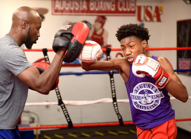 Rayonta Whitfield Jr., 15, works out with his dad, Rayonta Whitfield, at the Augusta Boxing Club on June 12, 2018. The club will host its first tournament Saturday, May 22, at Augusta Regional Airport.