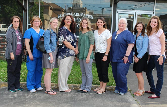 Beauregard Parish schools employee ten RNs who serve as school nurses in the thirteen schools across the parish. They include (from left) Lacey Duncan (MHS), Trisha Strother (CE/BAP), Dana Primeaux (PWE), Sonya Cook (SB), Emily Reeves (SHS), Natalie Redditt (SB), Andrea Ferguson (DHS and Nurse Coordinator), Melissa Warner (KRH), April Connelly (DJHS), and joining via live phone video Tessa Simmons (EB).