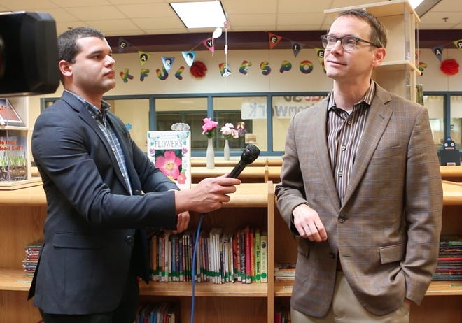 """Texas Education Commissioner Mike Morath stopped by Early Elementary School Tuesday morning as part of a visit to rural schools. Accompanied by representatives of the TEA, Region Service Center 15 in San Angelo and the Early school district, Morath visited several classrooms to observe math and literacy skills being taught. Morath, who is pictured standing next to TEA Region Service Center liaison Adam Powell, talks with the media in the school's library. Morath said he was present to """"watch and learn what our schools are doing."""" See Friday's print edition and www.brownwoodtx.com for additional details."""