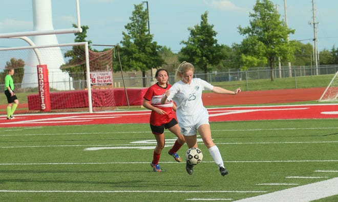 Augusta's Emily Wells (25) dribbles up the field in the first round match against Rose Hill on Monday, May 17 at Rose Hill High School.