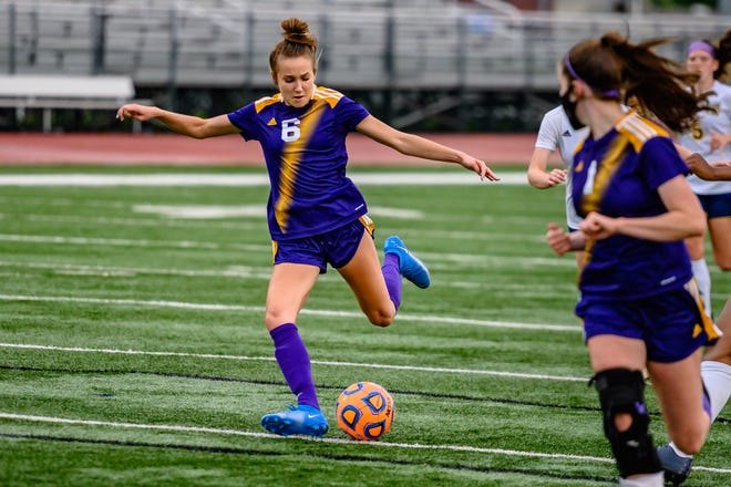 Hickman's Ella Leigh (6) shoots her first of two goals against Battle during a Class 4 District 8 semifinal match Monday night at Hickman High School.