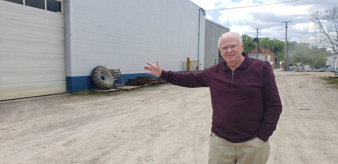 Richard Rogovin shows how the company would like to expand its facilities with a new building if the city accepts the company's request to permanently close the 200 block of Gomber Avenue.