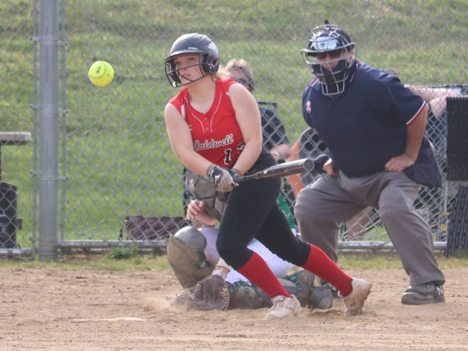 Caldwell senior Regan Wheeler connects during Monday's Division IV district semi-final game with Conotton Valley  at Franklin Park in Strasburg.