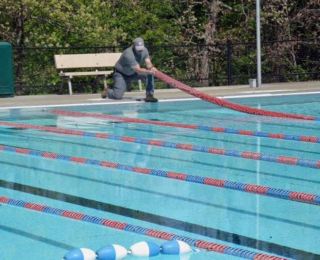 Wooster City Parks and Recreation Department employee Matt Cruise adjusts lane markers at the Christmas Run Pool in Wooster for the upcoming season. Christmas Run pool opens June 1, with Freedlander Pool and Knights Field Sprayground reopening May 29.