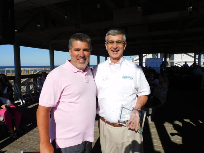Ken Wampler (right), President of Newman-Dailey Resort Properties, receives the Destin Chamber's Business Person of the Month award from Chamber Chairman Jerry Sullivan of Century 21 Blue Marlin Pelican, during the Chamber's May 14 Business Before Hours at Henderson Beach State Park.