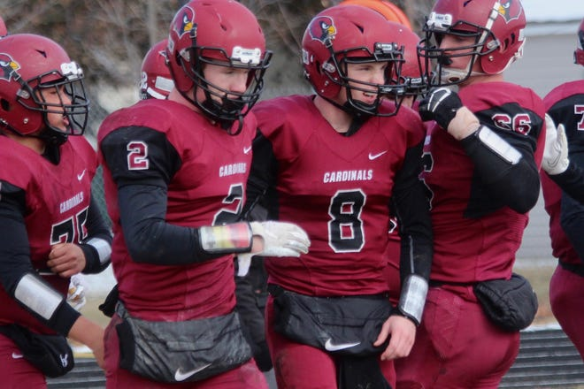 Grant Romfo (left) and Simon Romfo (right) take the field before a playoff game against Thompson on Oct. 24 at Langdon Area High School.