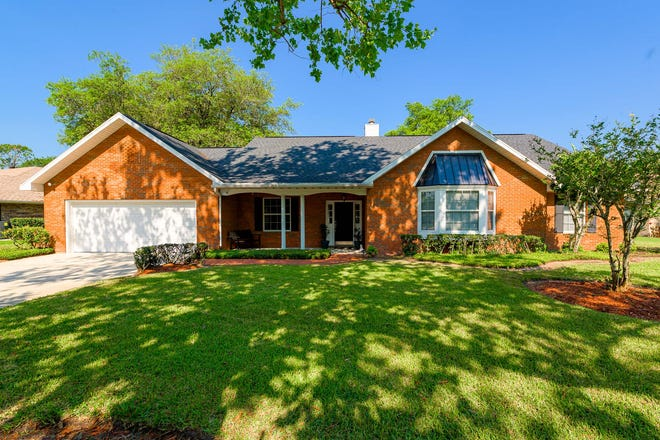 This impeccably maintained home in Ormond Beach's desirable community of Breakaway Trails holds three bedrooms, two-and-a-half baths and a custom solar-heated pool and spa.