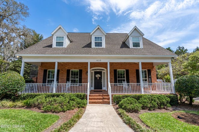 This brick beauty in the heart of Ormond Beach is filled with traditional charm and warmth.