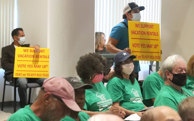 Supporters of vacation rentals and supporters of save our neighborhood pack the Volusia County council chambers, Tuesday May 18, 2021.