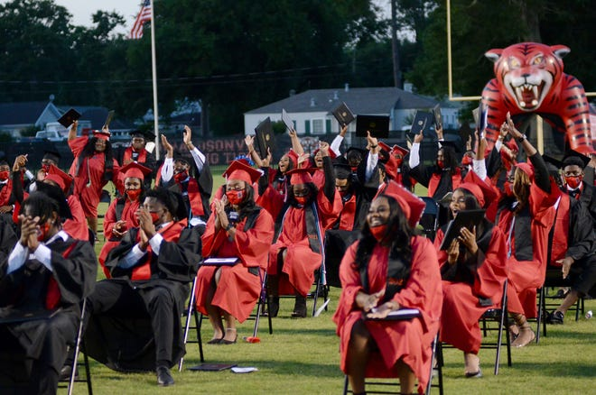 Donaldsonville High School's Class of 2021 applaud during the graduation ceremony held May 14 at Floyd Boutte Memorial Stadium.