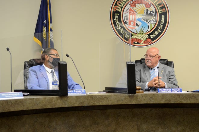 Donaldsonville City Council members Reginald Francis and Raymond Aucoin discuss an ordinance during the May 11 meeting.