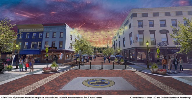 Shown is the proposed view of the shared street plaza at 9th and Main Streets.