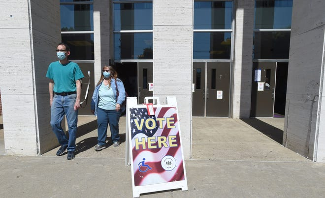 Tom Breter of Erie and his wife Dee Breter leave Erie High School on May 18, 2021, after voting in the municipal primary.