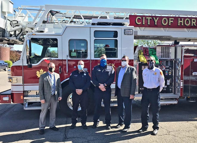 From left to right: Hornell Mayor John Buckley, new Hornell Fire Department Captains Jordan Pelton and Joel Guthrie, Public Safety Commissioner Dave Parmley and Hornell Fire Chief Frank Brzozowski.