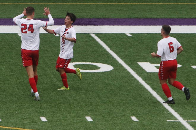 Southeastern Community College's Ryuga Uchigashima (16) is congratulated by teammate Joep De Bruin (24) after scoring the team's second goal during the Regional XI game against Hawkeye Community College Tuesday May 18, 2021 at Bracewell Stadium in Burlington.