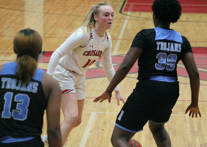 Bishop Kenny guard Maddie Millar dribbles against the Ribault defense in February's FHSAA Region 1-4A girls basketball semifinal.